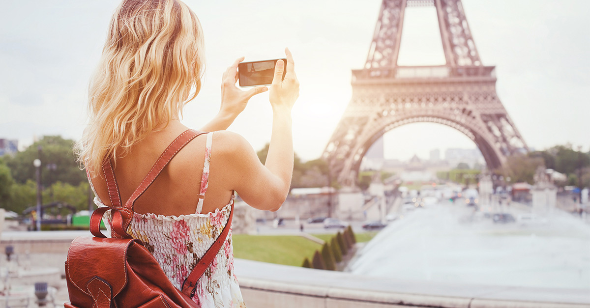 A traveler in France. Digital verification improved her customer experience by confirming her eligibility for a loyalty perk.
