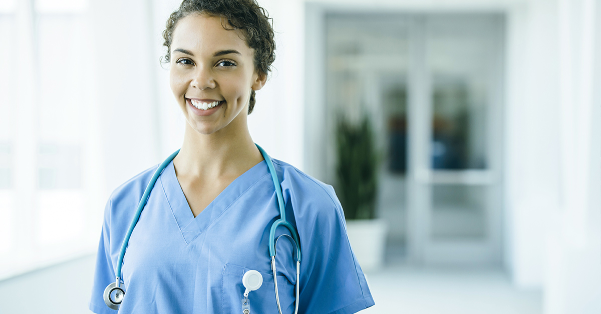 A photo of a smiling nurse. Marketing to nurses with exclusive offers is a great way to boost customer acquisition and loyalty.